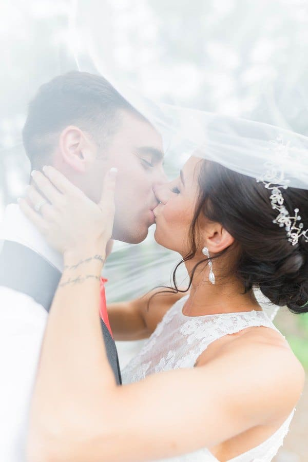 the bride and the groom's first kiss